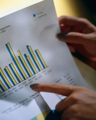Businesswoman Holding Bar Graph